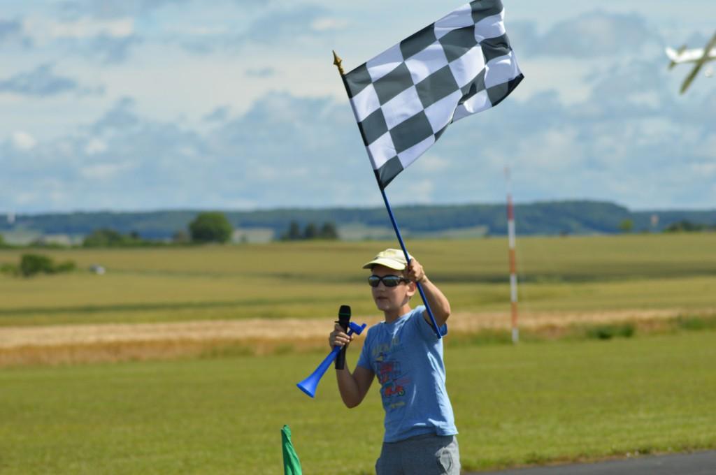 le damier signale la fin d'une course et de ses trois minutes de folie
